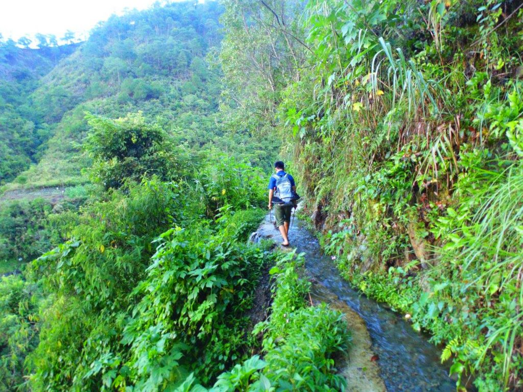 Following an irrigation canal to Humuyyo Falls.